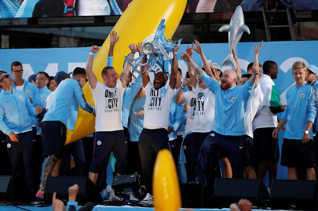 Soccer Football - Premier League - Manchester City Premier League Title Winners Parade - Manchester, Britain - May 14, 2018 Manchester City's Raheem Sterling lifts the Premier League trophy during the parade Action Images via Reuters/Andrew Boyers