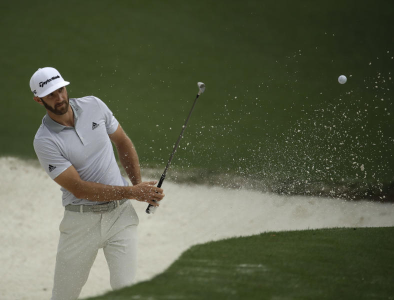 FILE - In this Wednesday, April 5, 2017, file photo, Dustin Johnson hits from a bunker on the 10th hole during a practice round for the Masters golf tournament, in Augusta, Ga. The world's No. 1-ranked player was forced to withdraw from the Masters on Thursday because of a lower back injury suffered less than 24 hours earlier in a freak fall at the home he was renting for the week. (AP Photo/Charlie Riedel, File)