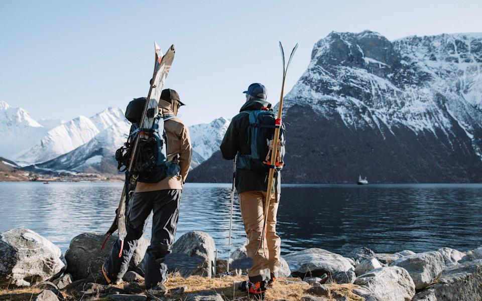 Hiking up to the perfect ski spot from HMS Gassten in Norway