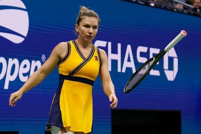 Simona Halep tosses her racket in her defeat to Elina Svitolina