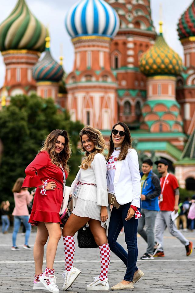 <p>Croatian fans pose for photographs at Red Square in Moscow on July 10, 2018, on the eve of the Russia 2018 World Cup semi-final football match between between Croatia and England. (Photo by MANAN VATSYAYANA / AFP) </p>
