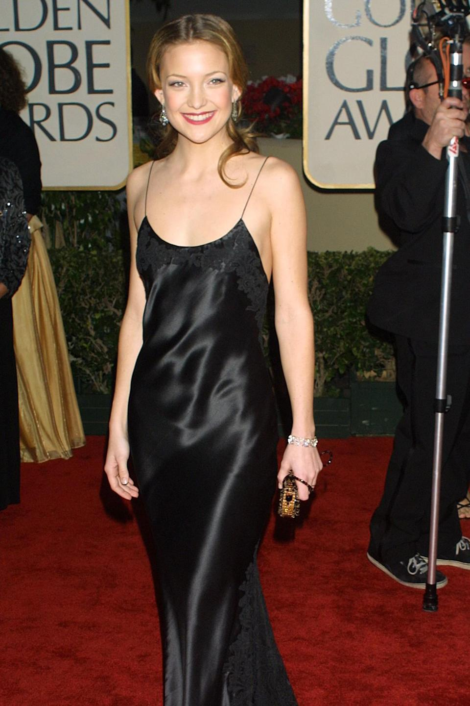 """<strong><h2>2001</h2></strong><br>A slip dress to the Golden Globes? Normally we'd say no way, but there's just something about Kate Hudson in Vera Wang that has us tossing normal red carpet rules out the window.<br><br><em>Kate Hudson in Vera Wang.</em><span class=""""copyright"""">Photo: KMazur/WireImage.</span>"""