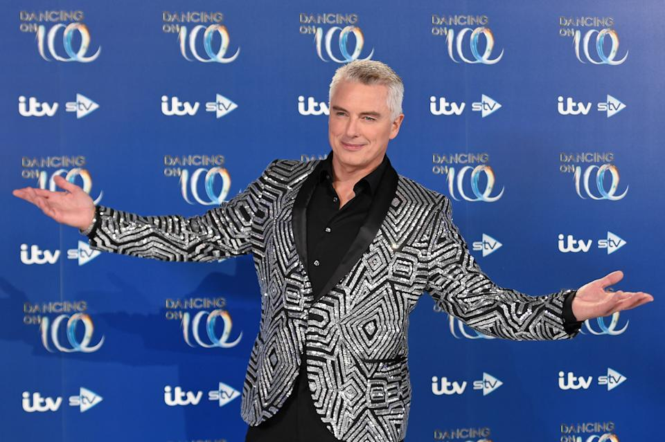 LONDON, ENGLAND - DECEMBER 09: John Barrowman during the Dancing On Ice 2019 photocall at ITV Studios on December 09, 2019 in London, England. (Photo by Stuart C. Wilson/Getty Images)