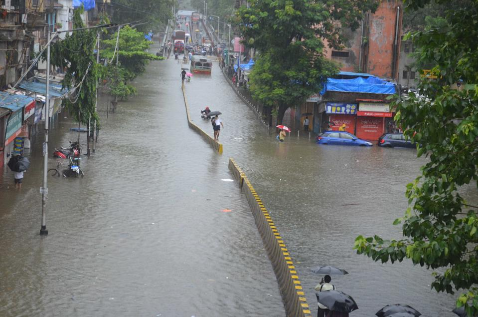 A general view of the flooded road due to heavy monsoon rainfall in Mumbai. (Photo by Arun Patil)