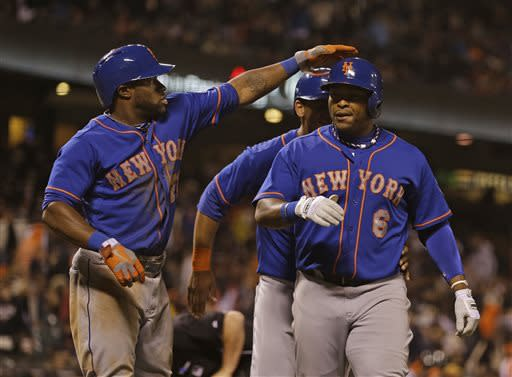 New York Mets' Marlon Byrd, right, is greeted by teammate Eric Young Jr., left, after hitting a grand slam home run to left field off San Francisco Giants relief pitcher Jake Dunning in the eighth inning of their baseball game Tuesday, July 9, 2013, in San Francisco. (AP Photo/Eric Risberg)