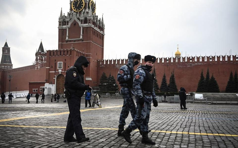 Russian law enforcement officers patrol Red Square amid a period of protests against the country's detainment of opposition leader Alexei Navalny. (AFP via Getty Images)