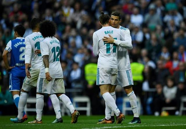 Real Madrid's forward Cristiano Ronaldo (R) celebrates with Gareth Bale during the Spanish league football match against Deportivo on January 21, 2018