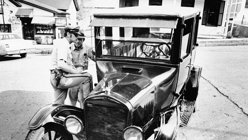If only they were arPolice officers check the damage to the 1925 Model T Ford owned by Burley Cave, an 80-year-old retired shoe factory worker, in Hannibal, Mo., April 21, 1971. (AP Photo)ound in the beginning.