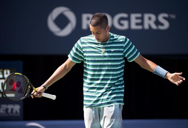 Nick Kyrgios of Australia gestures during a men's third round match against Andy Murray of Great Britain at the Rogers Cup tennis tournament in Toronto on Wednesday, Aug. 6, 2014. (AP Photo/The Canadian Press, Nathan Denette)