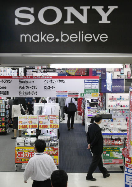 Shoppers look at an electronics store in Tokyo,Thursday, May 9, 2013. Sony Corp. is back in the black for the fiscal fourth quarter, recording a 93.9 billion yen ($948 million) profit, with big help from a weaker yen that boosts overseas earnings. (AP Photo/Koji Sasahara)