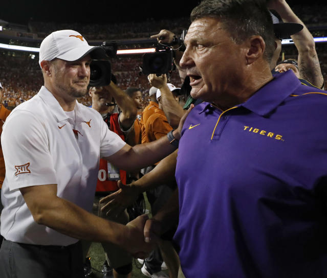 Texas Longhorns head coach Tom Herman (left) talks with LSU Tigers head coach Ed Orgeron after the game Saturday Sept. 7, 2019 at Darrell K Royal-Texas Memorial Stadium in Austin, Tx. LSU won 45-38. ( Photo by Edward A. Ornelas )