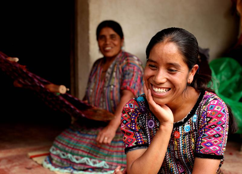This 2010 photo provided by Living on One shows Rosa Coj Bocel, right, who got a microloan to start a weaving business, with her mother in Pena Blanca, Guatemala. Four U.S. college students spent a summer living in Pena Blanca on $1 a day per person to learn about issues related to rural poverty, then made a film about their experiences. (AP Photo/Living on One)