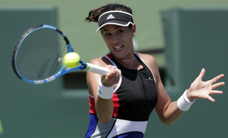 FILE - In this March 26, 2018, file photo, Garbine Muguruza, of Spain, returns to Sloane Stephens during the Miami Open tennis tournament in Key Biscayne, Fla.Muguruza will be competing in the French Open tennis tournament that begins on Sunday, May 27.(AP Photo/Lynne Sladky, File)
