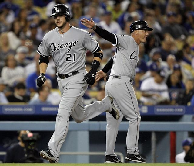 Chicago White Sox third base coach Joe McEwing, right, congratulates Tyler Flowers on his solo home run against the Los Angeles Dodgers in the fourth inning of a baseball game Tuesday, June 3, 2014, in Los Angeles. (AP Photo/Alex Gallardo)