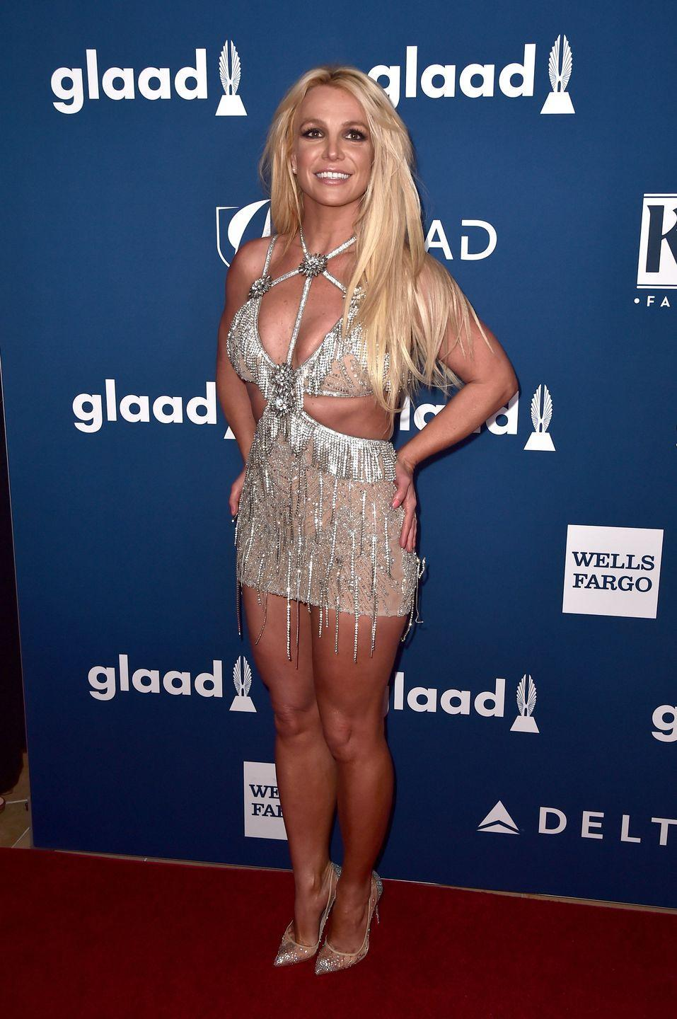 <p>Britney Spears stuns in a sparkly cut-out mini dress at the 29th Annual GLAAD Media Awards on April 12, 2018.</p>