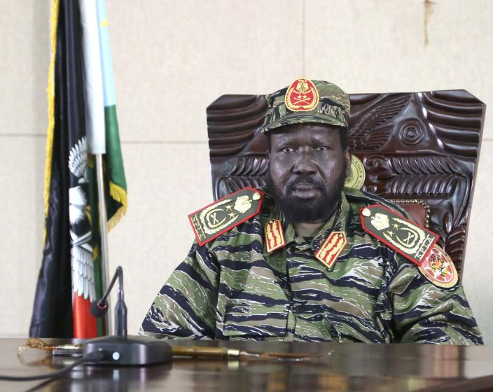 South Sudan's President Salva Kiir sits in his office in capital Juba December 16, 2013. The South Sudanese president declared a curfew in the capital Juba on Monday after clashes overnight between rival factions of soldiers. The fighting broke out following months of tension after President Salva Kiir sacked his deputy Riek Machar in July. Kiir blamed troops loyal to Machar for the violence. Flanked by ministers and wearing combat fatigues rather than civilian clothes, Kiir declared an overnight curfew in Juba effective from Monday night. It would run each night from 6 p.m. to 6 a.m., he said. REUTERS/Hakim George (SOUTH SUDAN - Tags: CIVIL UNREST POLITICS)