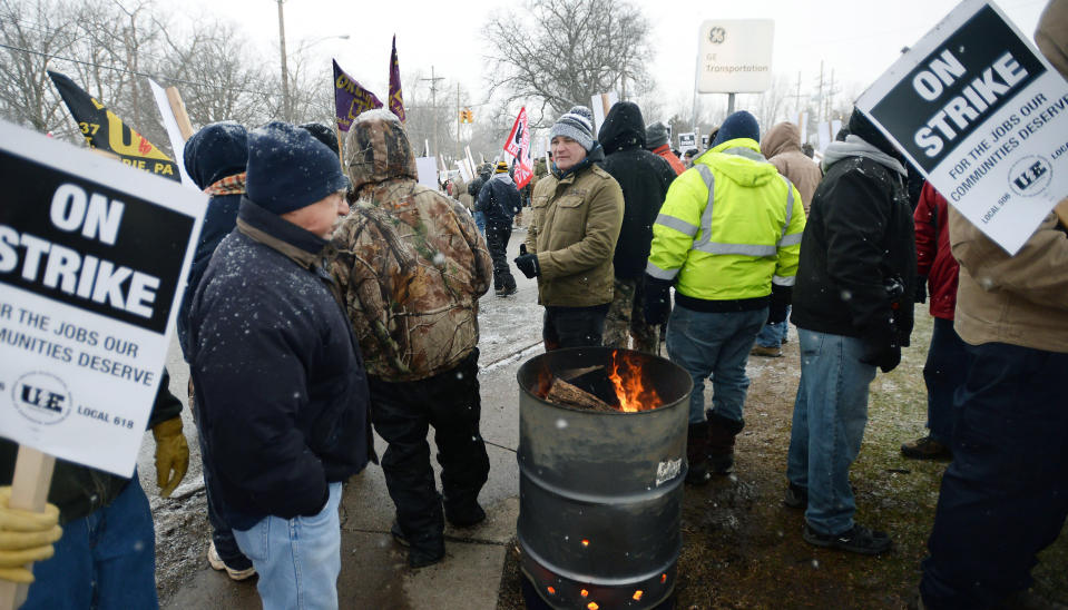 """Wabtec Corp. employees, who are members of UE Local 506, strike near the west gate of the former GE Transportation plant, now owned by Westinghouse Airbrakes Technologies Corp., in Lawrence Park Township, Erie County, Pa., on Tuesday, Feb. 26, 2019. Leaders of UE Locals 506 and 618 said in a statement that they were unable to convince the company to negotiate what they called an """"acceptable short term agreement that preserves the wages, benefits, and working conditions"""" for more than 1,000 employees. (Greg Wohlford/Erie Times-News via AP)"""