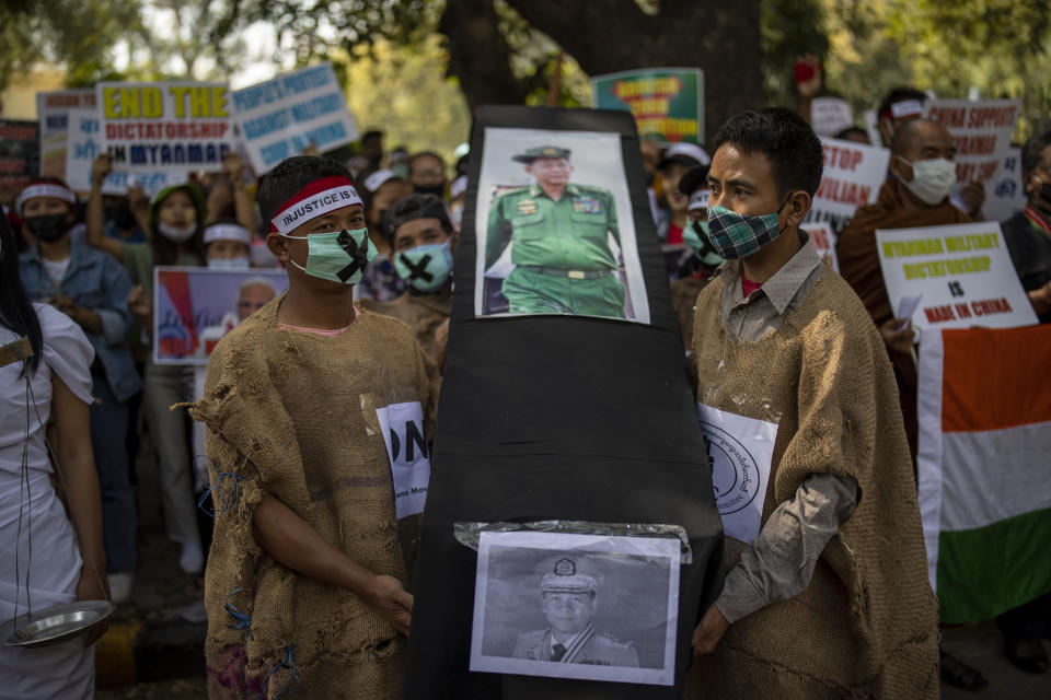Chin refugees from Myanmar carry a mock coffins of Commander in chief, Senior Gen. Min Aung Hlaing during a protest against military coup in Myanmar, in New Delhi, India, Wednesday, March 3, 2021. (AP Photo/Altaf Qadri)
