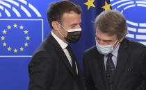 French President Emmanuel Macron, left, talks to European Parliament President David Sassoli during the Europe Day event and the Conference on the Future of Europe, Sunday, May 9, 2021 at the European Parliament in Strasbourg, eastern France. (Frederick Florin, Pool via AP)
