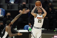 Denver Nuggets guard Austin Rivers, right, shoots as Los Angeles Clippers center DeMarcus Cousins defends during the second half of an NBA basketball game Saturday, May 1, 2021, in Los Angeles. (AP Photo/Mark J. Terrill)