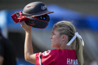 Canada's Victoria Hayward holds her helmet aloft during the softball game between Mexico and Canada at the 2020 Summer Olympics, Wednesday, July 21, 2021, in Fukushima , Japan. (AP Photo/Jae C. Hong)