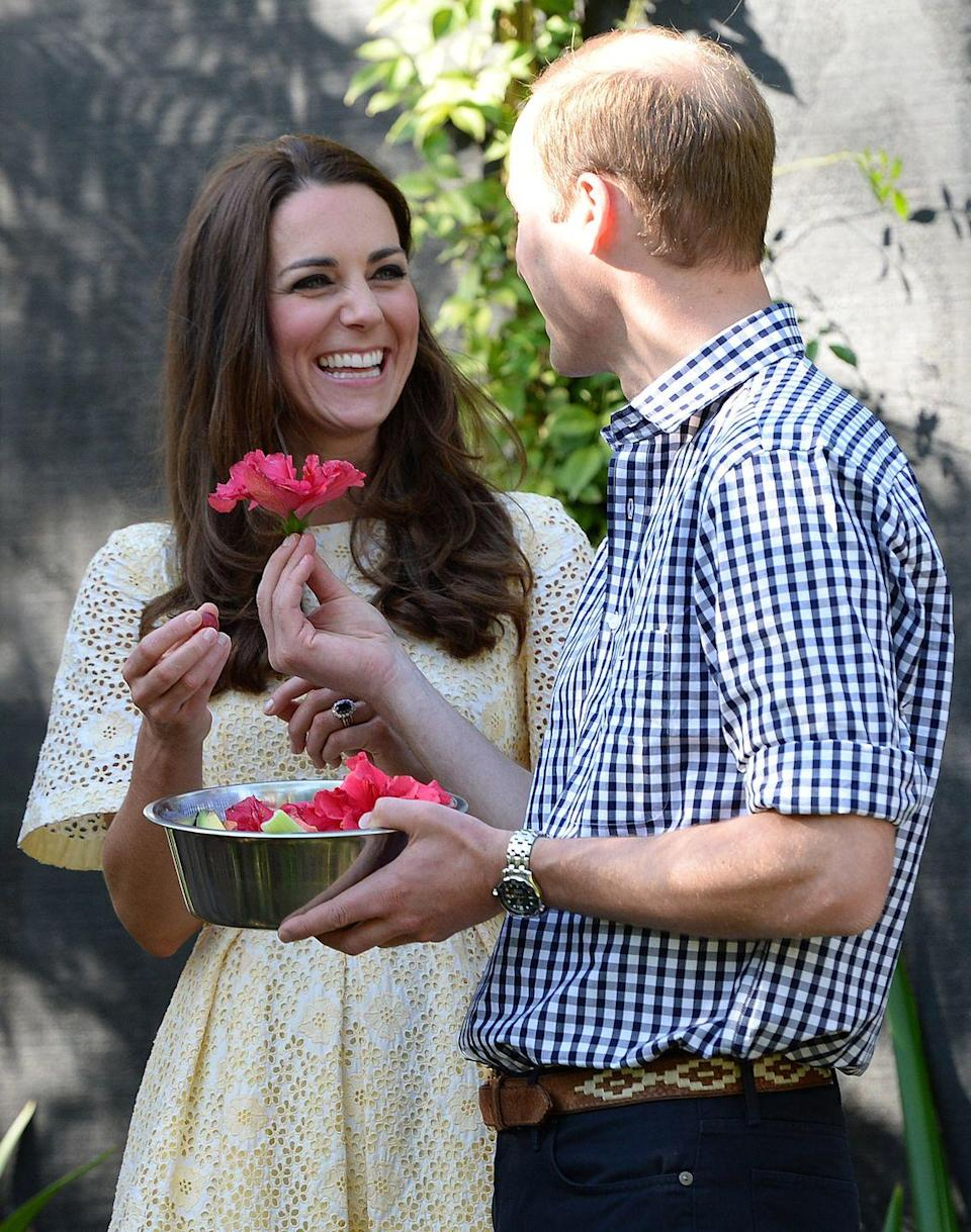 <p>The Duke of Cambridge handed the Duchess a flower during their visit to the Bilby Enclosure at Taronga Zoo in April 2014. The trip marked their first official visit overseas with their newborn son, Prince George. </p>