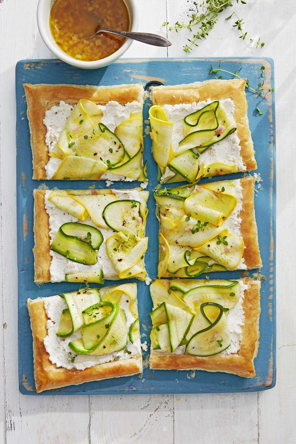 """<p>Thinly sliced and marinated zucchini and summer squash add an elegant twist to this simple summer tart.</p><p><strong><a href=""""https://www.countryliving.com/food-drinks/a28610238/marinated-squash-tart-recipe/"""" rel=""""nofollow noopener"""" target=""""_blank"""" data-ylk=""""slk:Get the recipe"""" class=""""link rapid-noclick-resp"""">Get the recipe</a>.</strong></p>"""