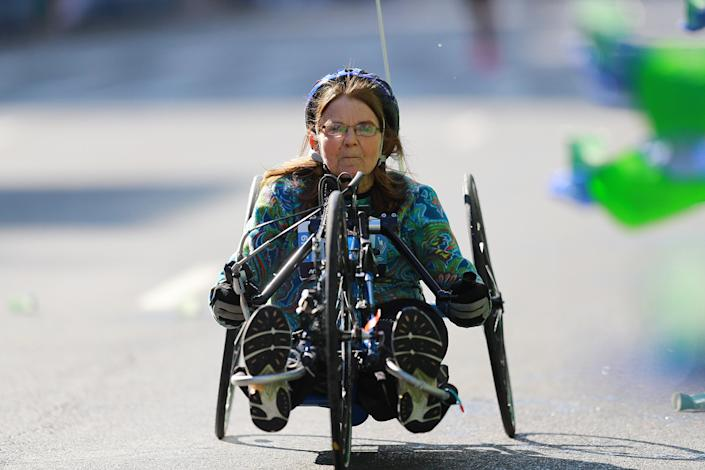 A wheelchair racer makes her way up First Avenue during the 2019 TCS New York City Marathon, Nov. 3, 2019 in New York City. (Photo: Gordon Donovan/Yahoo News)