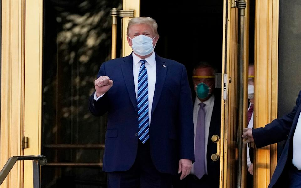 President Donald Trump walked out of Walter Reed National Military Medical Center to return to the White House after receiving treatments for Covid-19 - AP