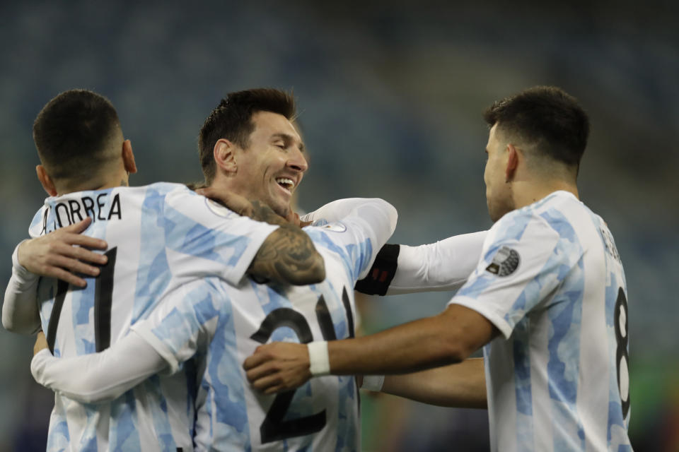 Argentina's Alejandro Gomez, center left, celebrates scoring the opening goal against Bolivia with teammates Lionel Messi, center right, Marcos Acuna, right, and Angel Correa during a Copa America soccer match at Arena Pantanal stadium in Cuiaba, Brazil, Monday, June 28, 2021. (AP Photo/Bruna Prado)