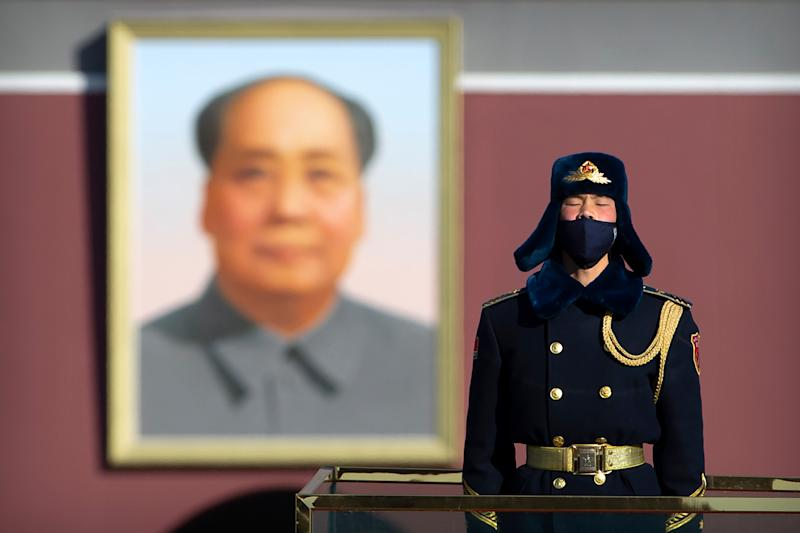<strong>A member of a Chinese honour guard wears a face mask as he stands guard on Tiananmen Square in Beijing, Tuesday, Feb. 4.</strong> (Photo: ASSOCIATED PRESS)