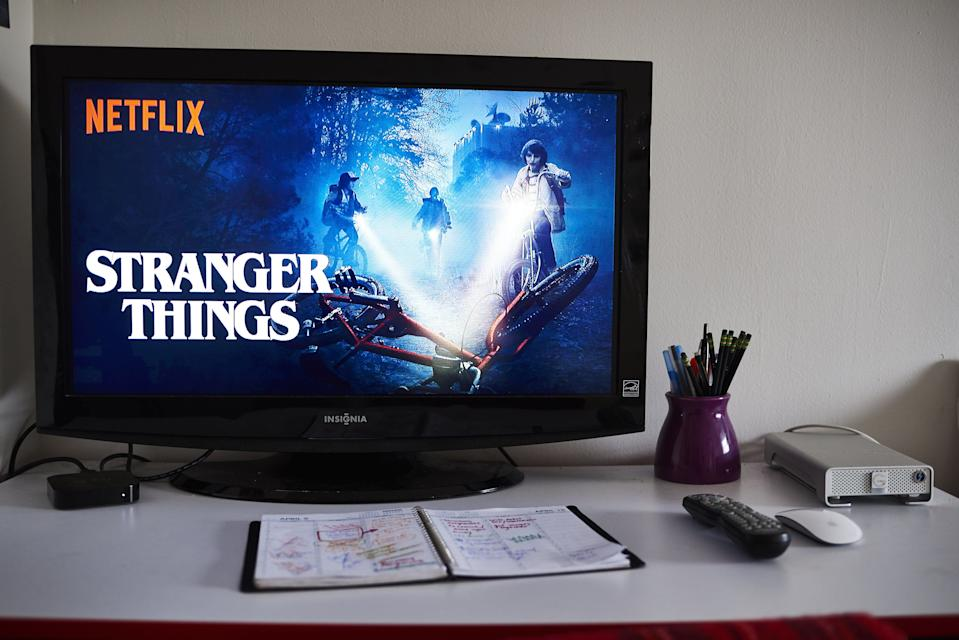 """A television monitor displays the home screen for the Netflix Inc. original series """"Stranger Things."""" Photographer: Gabby Jones/Bloomberg/Getty"""