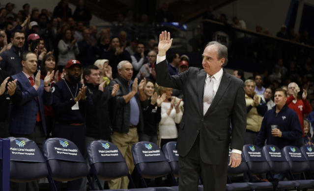 Temple head coach Fran Dunphy acknowledges the crowd before an NCAA college basketball game against Temple, Wednesday, Dec. 5, 2018, in Villanova, Pa. Dunphy is retiring from Temple at the end of the season. (AP Photo/Matt Slocum)