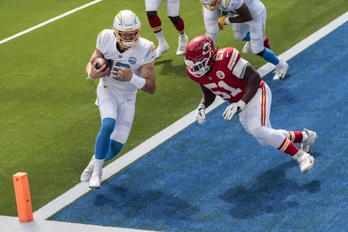Chargers quarterback Justin Herbert is hit by Chiefs defensive end Mike Danna.