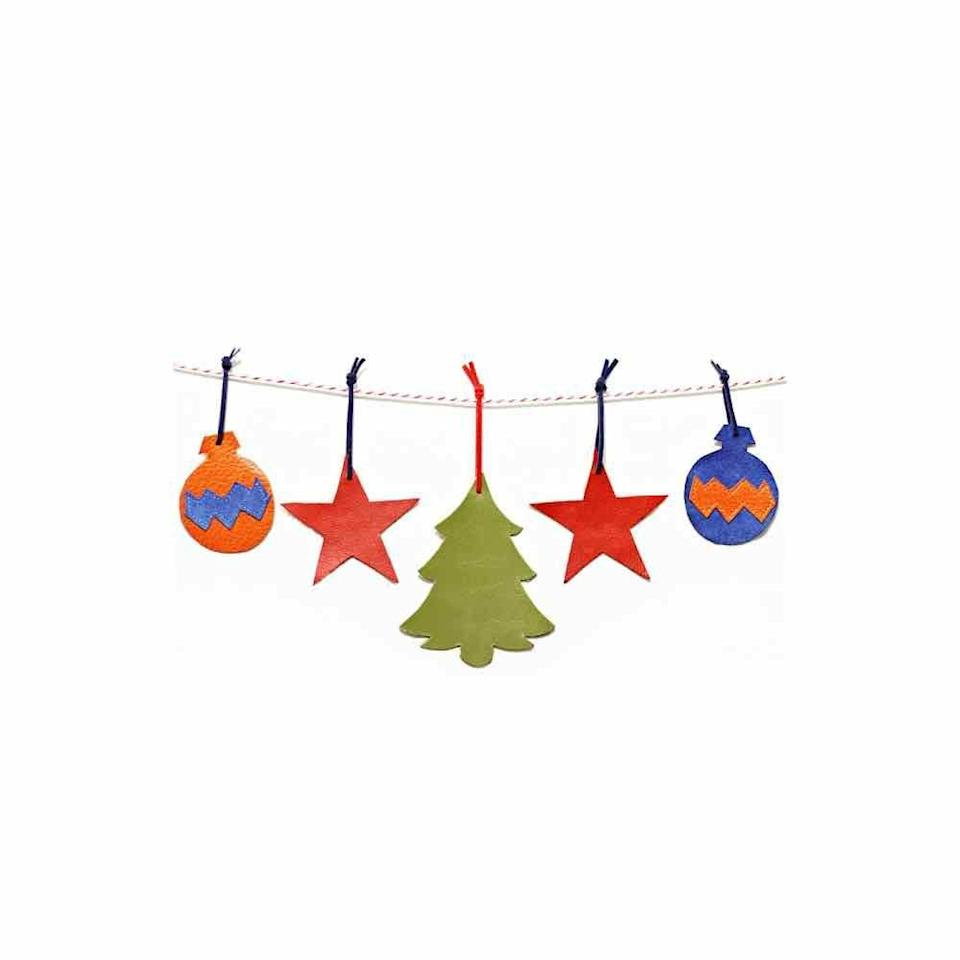 """<p>For an ornament that's sure to stand the test of time, consider using colorful (faux) leather. Some cutting machines will seamlessly make the shapes for you. </p><p><em>Get the tutorial at <a href=""""https://www.scatteredthoughtsofacraftymom.com/simple-leather-ornaments/"""" rel=""""nofollow noopener"""" target=""""_blank"""" data-ylk=""""slk:Scattered Thoughts of a Crafty Mom"""" class=""""link rapid-noclick-resp"""">Scattered Thoughts of a Crafty Mom</a>.</em></p><p><a class=""""link rapid-noclick-resp"""" href=""""https://www.amazon.com/ZIIYAN-20x34cm-Colored-Leather-Upholstery/dp/B07SGBF72W?tag=syn-yahoo-20&ascsubtag=%5Bartid%7C10072.g.34443405%5Bsrc%7Cyahoo-us"""" rel=""""nofollow noopener"""" target=""""_blank"""" data-ylk=""""slk:SHOP COLORED FAUX LEATHER SHEETS"""">SHOP COLORED FAUX LEATHER SHEETS</a></p>"""