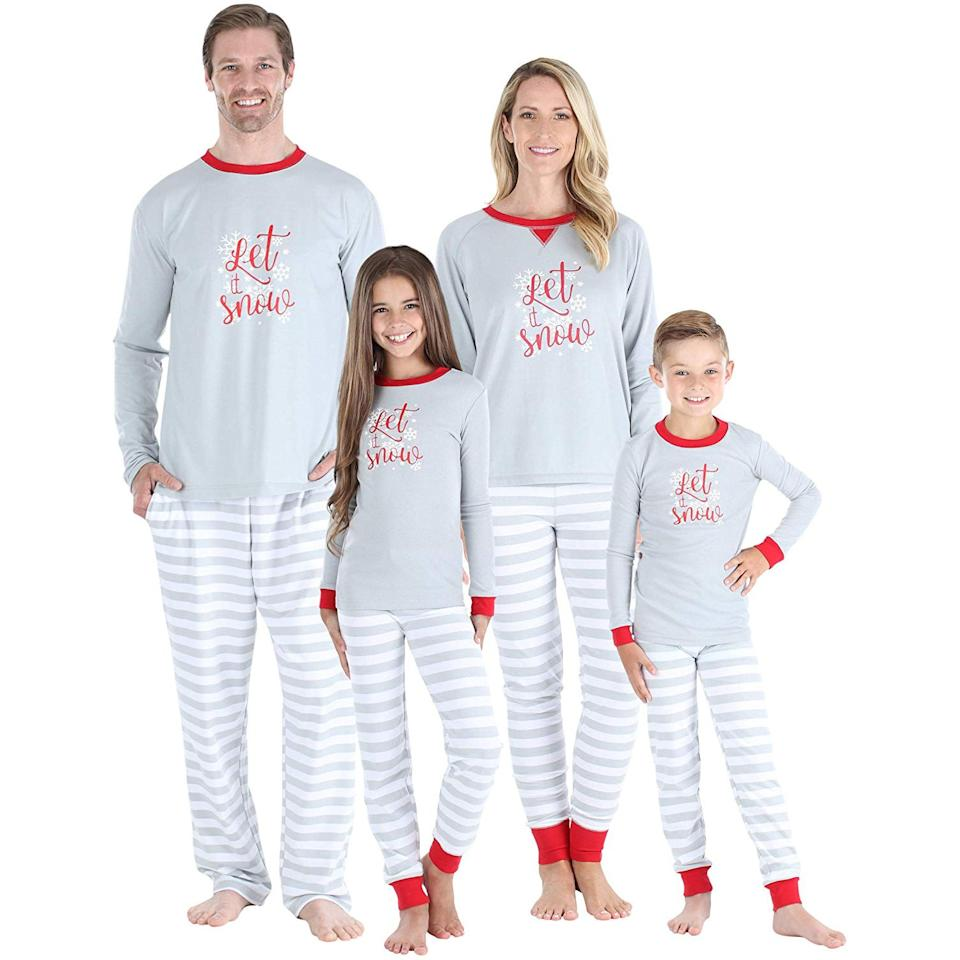 """<p>Celebrate the snowy season with these matching PJs. The long-sleeve knit jersey tops display the phrase """"Let it Snow"""" and feature a subtle snowflake design while lightweight striped bottoms contribute to the classic look that's as cute as it is comfy.</p> <p><strong>To buy:</strong> From $7; <a href=""""https://www.amazon.com/Sleepyheads-Holiday-Family-Matching-Snowflake/dp/B079T3FWR8/ref=as_li_ss_tl?ie=UTF8&linkCode=ll1&tag=rslifefamilychristmaspajamasccalucchia0919-20&linkId=47aecb6b88d218f97020027f8540d5e4"""" target=""""_blank"""">amazon.com</a>.</p>"""