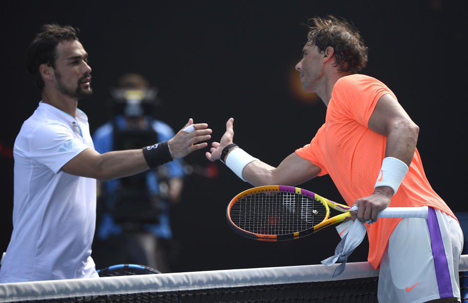Spain's Rafael Nadal, right, is congratulated by Italy's Fabio Fognini after winning their fourth round match at the Australian Open tennis championship in Melbourne, Australia, Monday, Feb. 15, 2021.(AP Photo/Andy Brownbill)