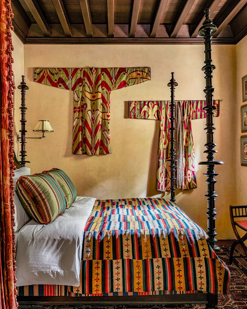 A vintage Mexican textile covers the guest bed.