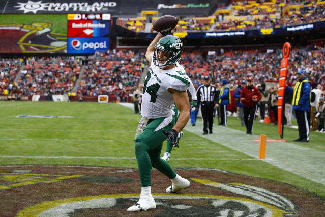 FILE - In this Sunday, Nov. 17, 2019 file photo, New York Jets tight end Ryan Griffin (84) celebrates his touchdown during the first half of an NFL football game against the Washington Redskins in Landover, Md. Ryan Griffin has been so sure-handed lately for the New York Jets that he ended up on a T-shirt. Griffin had five catches for 109 yards the first 100-yard game of his seven-season career and a touchdown at Washington. He has 25 receptions for 269 yards and career-high four TDs while becoming reliable target for Darnold in the absence of the injured Chris Herndon. (AP Photo/Patrick Semansky, File)