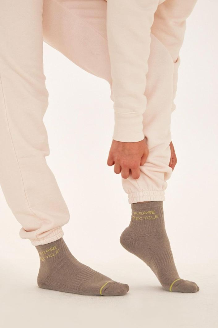 <p>These <span>Girlfriend Collective Neon Please Recycle Quarter Crew Socks</span> ($14) come in so many cute colors.</p>