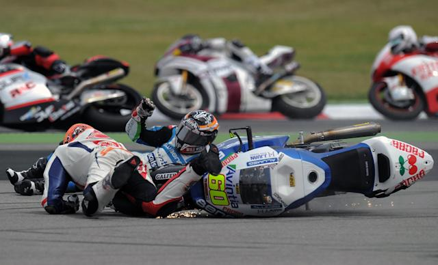 TOPSHOTS-Blusens Avintia's Spanish Julian Simon (R) and Speed Master Mike Di Meglio (L) crash during the Moto2 race of the Catalunya Moto GP Grand Prix at the Catalunya racetrack in Montmelo, near Barcelona, on June 3, 2012. Speed Master's Italian Andrea Iannone won the race ahead of Interwetten-Paddock's Swiss Thomas Luthi and Team CatalunyaCaixa Repsol 's Spanish Marc Marquez. AFP PHOTO / LLUIS GENELLUIS GENE/AFP/GettyImages