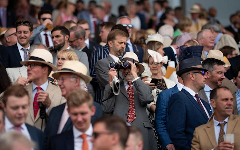 Racegoers on the final day of racing at Glorious Goodwood 2019 in Sussex - CHRISTOPHER PLEDGER