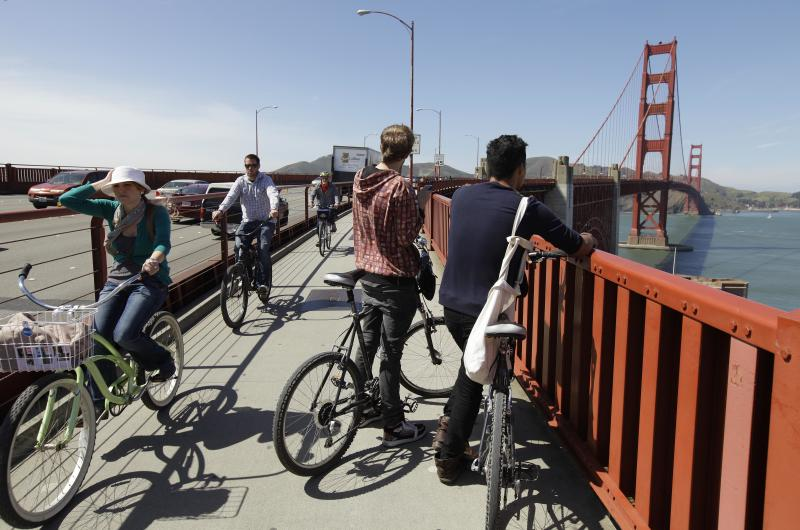 "In this photo taken Wednesday, April, 18, 2012, bicyclists are shown on the Golden Gate Bridge in San Francisco. It served as a picturesque backdrop for Jimmy Stewart and Kim Novak's tensely romantic first meeting in ""Vertigo"" in 1958, made the cover of Rolling Stone in the '70s and was nearly decimated by a falling Romulan drill-of-death in 2009's ""Star Trek."" One way or another, the Golden Gate Bridge has packed a lot of history into its 75-year span. (AP Photo/Eric Risberg)"