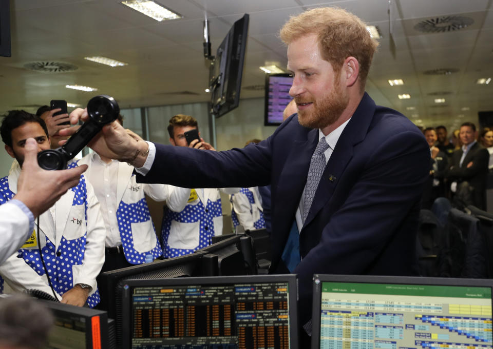 LONDON, UNITED KINGDOM - SEPTEMBER 11:  Prince Harry, Duke of Sussex s handed a phone as he attends the 15th annual BGC Charity Day, on September 11, 2019 in London, England. The annual day is to commemorate the 658 Cantor Fitzgerald and the 61 EuroBrokers employees who lost their lives in the 9/11 attacks. (Photo by Kirsty Wigglesworth - WPA Pool/Getty Images)