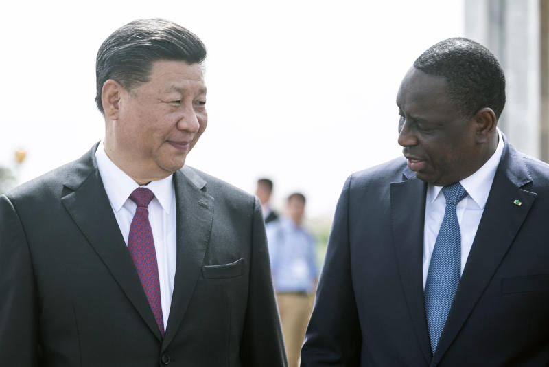 Senegal president Macky Sall, right, and Chinese President Xi Jinping, arrive at the State House in Dakar, Senegal, on the first day of a state visit Saturday, July 21, 2018. Chinese President Xi Jinping arrived in Africa on Saturday on a four-nation visit, seeking deeper military and economic ties.(AP Photo/Xaume Olleros)