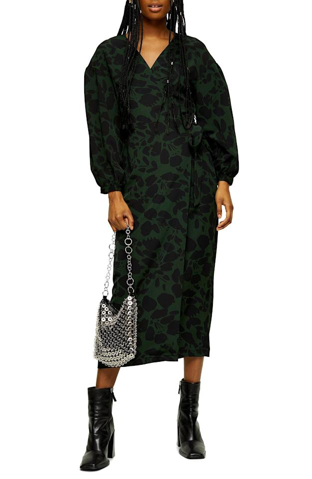 """<p><a href=""""https://www.popsugar.com/buy/Topshop-Abstract-Drama-Long-Sleeve-Wrap-Midi-Dress-534913?p_name=Topshop%20Abstract%20Drama%20Long-Sleeve%20Wrap%20Midi%20Dress&retailer=shop.nordstrom.com&pid=534913&price=75&evar1=fab%3Aus&evar9=47042845&evar98=https%3A%2F%2Fwww.popsugar.com%2Fphoto-gallery%2F47042845%2Fimage%2F47043270%2FTopshop-Abstract-Drama-Long-Sleeve-Wrap-Midi-Dress&list1=shopping%2Cnordstrom%2Cwinter%20fashion&prop13=api&pdata=1"""" rel=""""nofollow"""" data-shoppable-link=""""1"""" target=""""_blank"""" class=""""ga-track"""" data-ga-category=""""Related"""" data-ga-label=""""https://shop.nordstrom.com/s/topshop-abstract-drama-long-sleeve-wrap-midi-dress/5524273/full?origin=category-personalizedsort&amp;breadcrumb=Home%2FWomen%2FNew%20Arrivals&amp;color=black%20multi"""" data-ga-action=""""In-Line Links"""">Topshop Abstract Drama Long-Sleeve Wrap Midi Dress </a> ($75)</p>"""