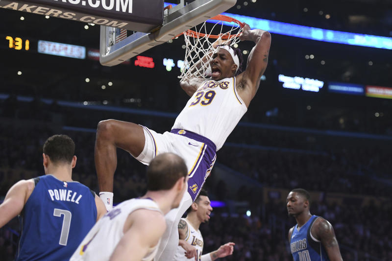 Los Angeles Lakers center Dwight Howard reacts after dunking against the Dallas Mavericks during the first half of an NBA basketball game Sunday, Dec. 29, 2019, in Los Angeles. (AP Photo/Michael Owen Baker)