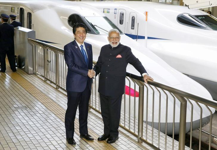Indian Prime Minister Narendra Modi nd Japan's Prime Minister Shinzo Abe pose in front of Shinkansen bullet train before heading for Hyogo prefecture at Tokyo Station