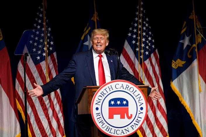 Former US President Donald Trump addresses the NCGOP state convention on 5 June, 2021 in Greenville, North Carolina. Mr Trump could end up getting legal defense from President Joe Biden's Justice Department. (Getty Images)