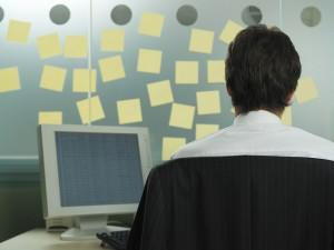 Person sits in front of blank post-its